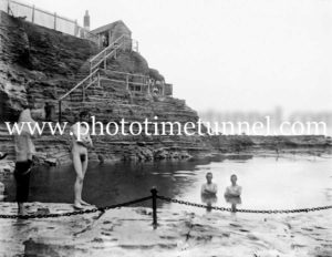 Nude bather at the Bogey Hole, Newcastle, NSW. c1910.