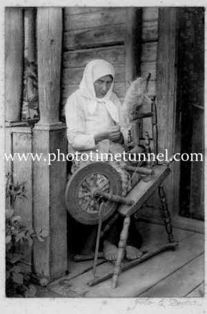 Old woman spinning yarn