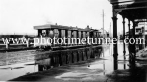 Steam tram in flooded Maitland street