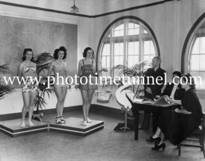 Mrs Toby Lynch and Miss Joan Nicholson viewing Jantzen swimsuits for Marcus Clark's store at Newcastle, NSW, circa 1940.