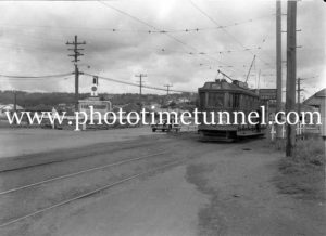 Tram and car at the Gully Line crossing, Broadmeadow, NSW, January 6, 1941.