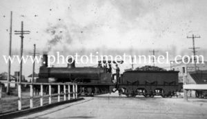 Coal train at the Gully Line crossing, Broadmeadow, NSW, circa 1930s.