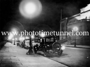 Night view of cars parked outside City Hall, Newcastle, NSW, circa 1930s.