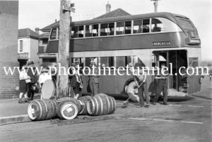 Traffic accident involving a bus and beer kegs, Newcastle, NSW, c1940s