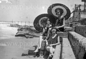 Women with parasols at a beach, Newcastle, NSW, circa 1920s.