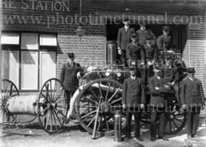 Vintage fire engine and firemen at Grafton Fire Station, circa 1910.
