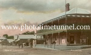 Main Street of Gloucester, NSW, showing Commercial Hotel, circa 1910. Hand-coloured photo.