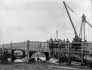 Repair work on the Belmore Bridge across the Hunter River, Maitland, NSW, circa 1900.