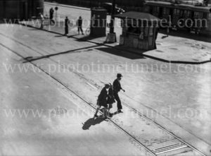 Family crossing the tram tracks in Hunter Street, Newcastle, near the news stand, circa 1930s