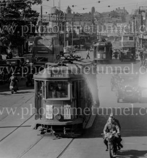 Trams, buses and other traffic at Hunter Street West, Newcastle, near Bank Corner, June 3, 1939.