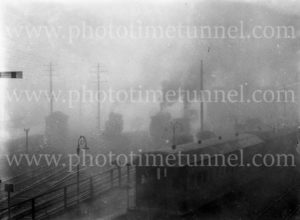 Smoggy view of railway yards, Newcastle, NSW, May 23, 1949.