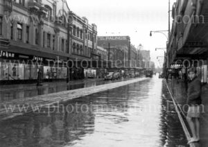 Young boy a rainy day in Hunter Street, Newcastle, June 6, 1946.