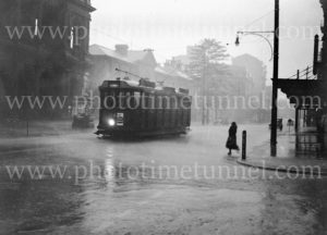Tram outside Newcastle Post Office, Hunter Street, on a rainy day, November 15, 1936.