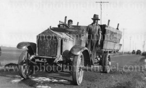 Young men with an Albion solid-tyred motor lorry, circa 1930s.