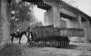 Boy on a horse inspecting a crashed lorry, Cessnock area NSW, circa 1930s.
