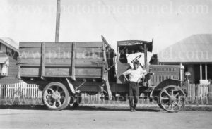 Man with an old solid-tyred motor lorry, circa 1930s. Cessnock area, NSW.