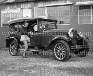 Girl in miniskirt with 1928 Chevrolet car at Newcastle, June 8, 1971.