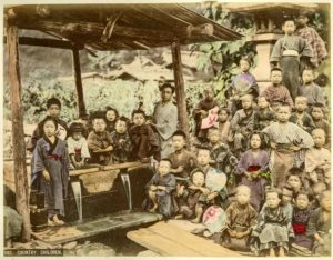 Country children, Japan. Hand-coloured print by Kimbei Kusakabe, circa 1900