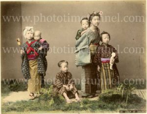 Group of children, Japan. Hand-coloured print by Kimbei Kusakabe, circa 1900.