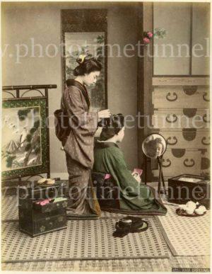 Hair dressing, Japan. Hand-coloured print by Kimbei Kusakabe, circa 1900.