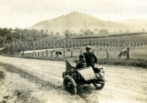 Couple on motorcycle and sidecar at Mount Hudson, near Rose Brook, Hunter Valley, NSW, circa 1940s.