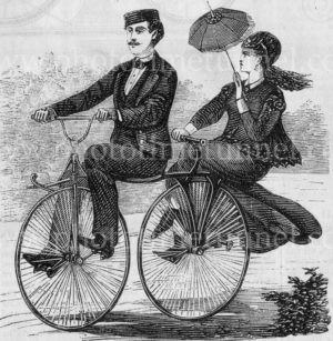 Gentleman and lady riding a vintage tandem bicycle, 1869. Vintage engraving.