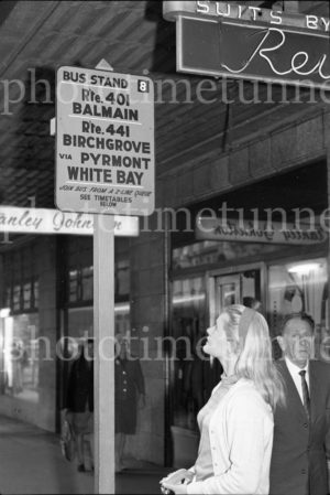 """Balmain bus"": Blonde woman waiting at a bus stop in Sydney, circa 1960s. (2)"