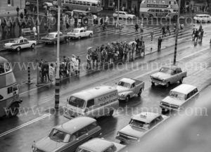 """Sunshine Bread"": Rainy day traffic in Sydney, circa 1960s."