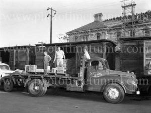 Shifting chocolates and sweets from a railway truck to a Nestle lorry at Customs House, Newcastle, NSW, May 5, 1964.