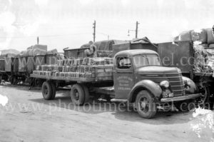 Roof tiles on a truck, Blakiston & Co transport, Geelong, Victoria, circa 1950.