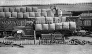 Blakiston truck with wool bales at railways goods yard, Geelong, Victoria, circa 1950. (2)