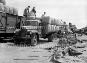 Blakiston truck with wool bales at railways goods yard, Geelong, Victoria, circa 1950.