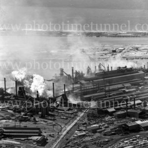 Aerial telephoto view of the BHP steelworks, Newcastle, NSW, showing Kooragang Island and North Stockton, March 31, 1968.