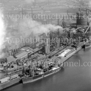 Aerial view of the BHP steelworks wharf, Newcastle, NSW, showing the ship Iron Wyndham, March 31, 1968.