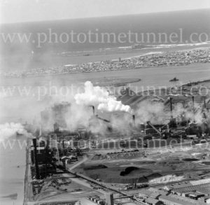 Aerial view of the BHP steelworks, Newcastle, NSW, showing Stockton and Nobbys Headland, March 31, 1968.
