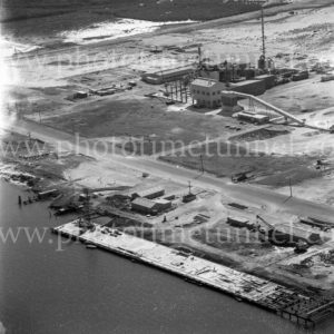 Aerial view of portion of Kooragang Island, Newcastle, NSW, showing remnants of Walsh Island dockyard wharfage, March 31, 1968.