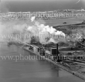 Aerial view of the BHP steelworks wharf, Newcastle, NSW, showing Stockton and Nobbys Headland, March 31, 1968.