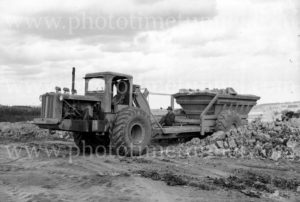 Heavy earthmoving machinery on a worksite, Victoria, circa 1950.