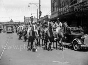 Horsemen and caricatures in patriotic youth march in Hunter Street, Newcastle, NSW, December 13, 1942.