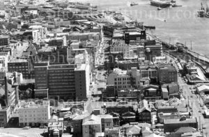 Aerial view of Newcastle East, showing the Irene Hall nurses' home and the Esplanade Hotel, 1977.