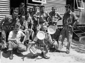 National servicemen watch a colleague juggle plates at Gan Gan army camp, Port Stephens, NSW, February 28, 1960. (2)