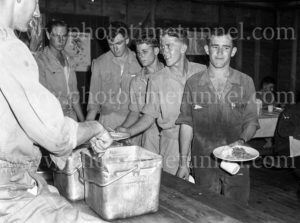 National servicemen queuing for food at the mess hut at Gan Gan army camp, Port Stephens, NSW, February 28, 1960.