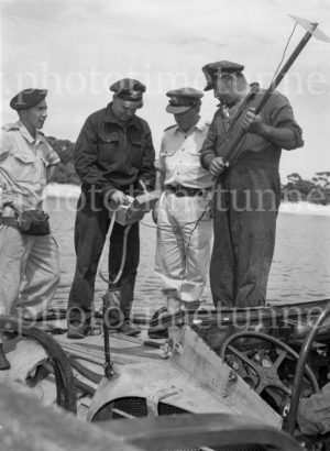 Officers standing on an amphibious vehicle at Gan Gan army camp, Port Stephens, NSW, February 28, 1960.