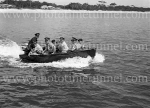 Military personnel in a motor boat during an exercise, Port Stephens, NSW, February 28, 1960.