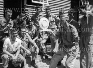 National servicemen watch a colleague juggle plates at Gan Gan army camp, Port Stephens, NSW, February 28, 1960.