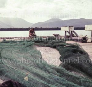 Fisherman mending nets near Cairns, Queensland, 1960s. (1)