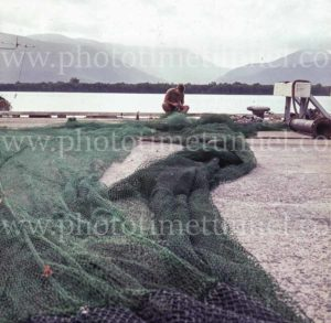 Fisherman mending nets near Cairns, Queensland, 1960s. (2)