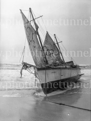 "Yacht ""Seafarer"" stranded on a beach."