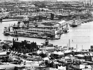 Telephoto view of Newcastle's Christ Church Cathedral and State Dockyard, circa 1970.