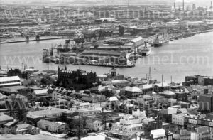 View of Newcastle, NSW, showing Christ Church Cathedral, steelworks and State Dockyard, circa 1970.